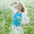 The happy young woman in the field of white wild flowers — Stock Photo #5448274