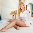 Young pretty woman in bed — Stock Photo #5476875