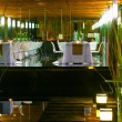 Empty tables in restaurant in night illumination - Foto Stock