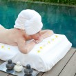 The young beautiful woman on Spa procedures in pool — Stock Photo