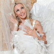 The happy bride tries on a wedding dress — Stock Photo #5629556