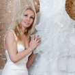 The happy bride tries on a wedding dress — Stock Photo #5629558