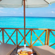 Plate with lobster on table and view on ocean — Stockfoto