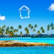 The house from clouds over the sea and palm trees - dream of the house — Stock Photo