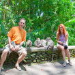 Tourists are photographed with monkeys in Sacred Monkey Forest in Ubud Bali — Stock Photo #6002419