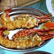 Plates with lobster on table — Stock Photo