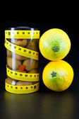 Healthy food - olive and lemons support a harmonous figure — Stock Photo