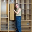 The man is engaged in assemblage of a new wardrobe — Stock Photo