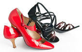 Female fashionable new shoes on a high heel of red and black color — Stock Photo