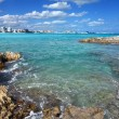 Stock Photo: Cancun.Rocky coast, seand city in distance