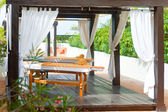 Pavilion for Spa procedures in tropical garden — Stock Photo