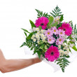 Stock Photo: Brawny man's hand with bouquet of flowers