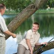 The father asks a fishing tackle from the son too to fish — Stock Photo #6589545
