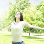 Young woman enjoying beautiful summer day — Stock Photo #5798950