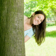 Happy young woman in park — Stock Photo