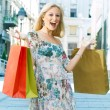 Excited shopping woman — Stock Photo #5799624