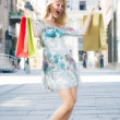 Excited shopping girl — Stock Photo