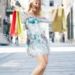 Stock Photo: Excited shopping girl