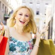 Excited shopping woman — Stock Photo #5799905