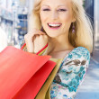 Smiling shopping girl — Stock Photo