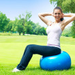 Fitness women exercising with pilates ball outdoors — Stock Photo #5917944