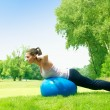 Stock Photo: Fitness women exercising with pilates ball outdoors