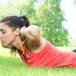 Fitness girl doing stretching exercise outdoors — Stock Photo #5920400