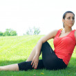 Active young women doing stretching exercise outdoors — Stock Photo