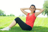Fitness girl doing stretching exercise outdoors — Stock Photo
