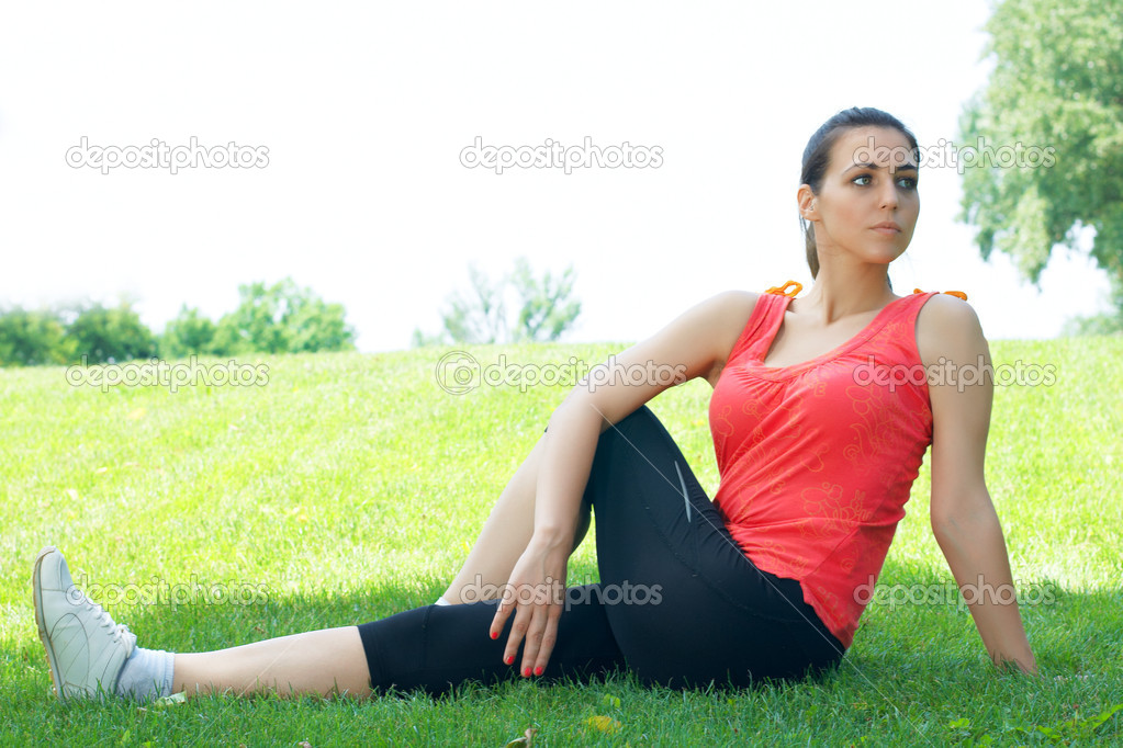 Active young women doing stretching exercise outdoors. — Stock Photo #5920468