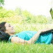 Happy student using laptop at the park — Stock Photo