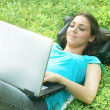 Happy student using laptop at the park — Stock Photo #6039655