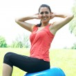 Fitness women exercising with pilates ball outdoors — Stock Photo #6040357