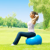 Fitness women exercising with pilates ball outdoors — Stock Photo