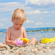 Two-year old boy playing on the beach — Stock Photo
