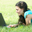 Happy young woman using laptop outdoors — Stock Photo #6338114