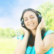 Beauty young woman with headphones outdoors — Stock Photo #6341460