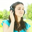 Beauty young woman with headphones outdoors — Stock Photo #6341724