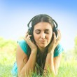 Relaxed girl with headphones listen the sounds of nature — Stock Photo #6342560