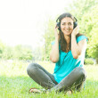 Beauty young woman with headphones outdoors — Stock Photo #6343742