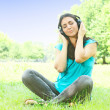 Beauty young woman with headphones outdoors — Stock Photo #6344018