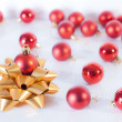 Christmas ball with bow — Stock Photo