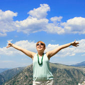 Happy young woman with wide open arms — Stock Photo
