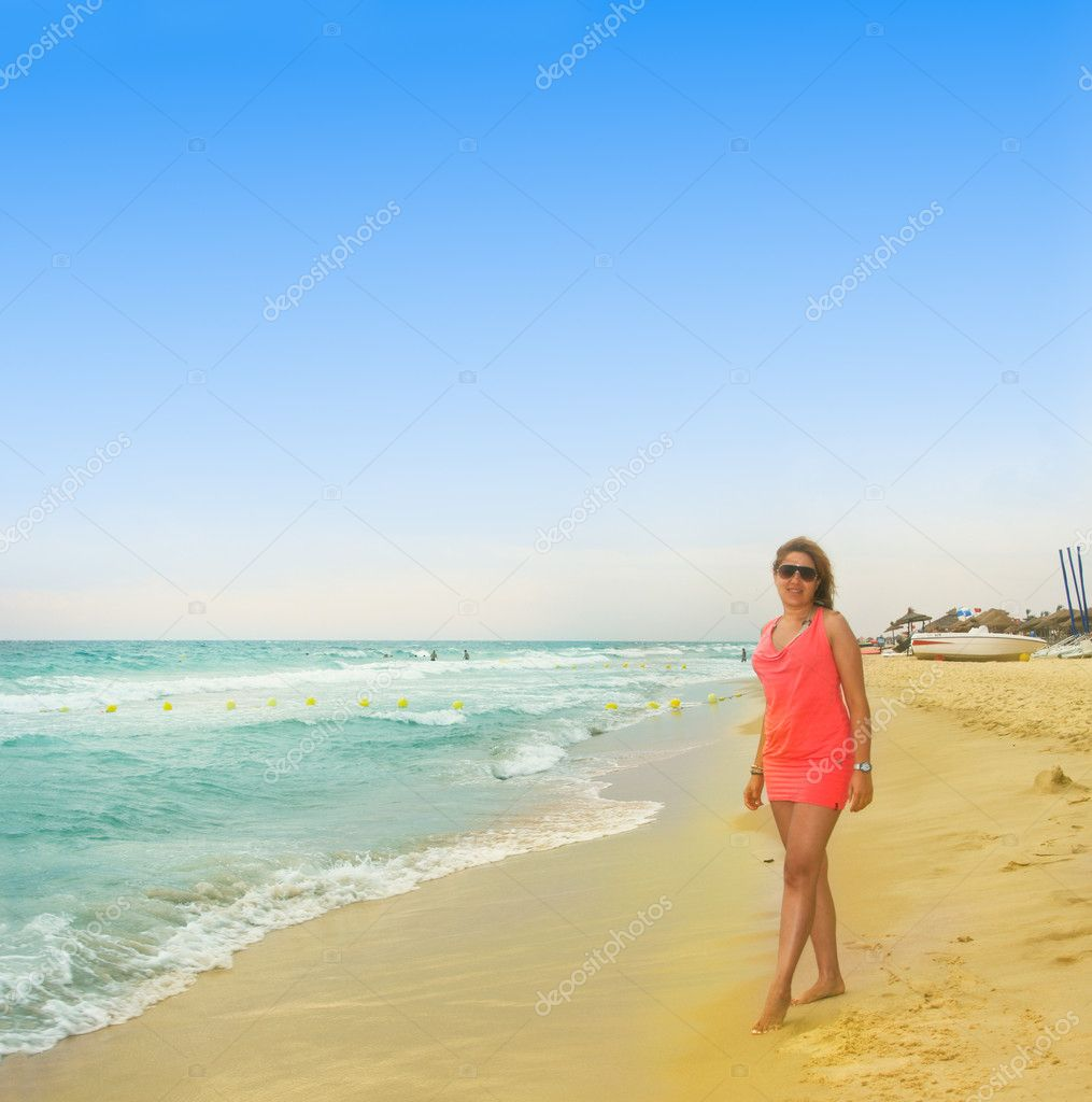 Happy girl standing on the beach - 75.6KB