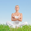 Portrait of young woman practicing yoga outdoors — Stock Photo