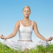 Portrait of relaxed young woman meditating outdoors — Stock Photo