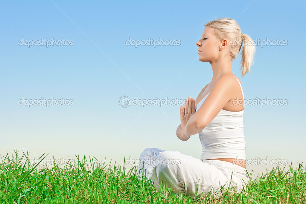 Young woman meditating outdoors with copyspace. — Stock Photo #6532971