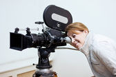 Looking through old movie camera — Stock Photo