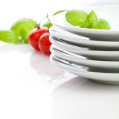 White plates on the table — Stock Photo