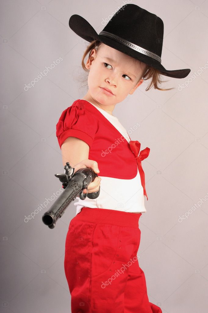 Beautiful little girl playing cowboy — Stock Photo #5416682